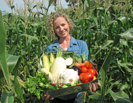 Kayla with Harvest in a Three Sisters Garden