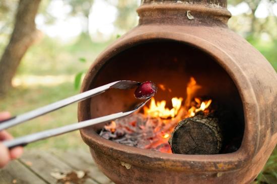 (Singeing Tunas in Fire.  Photo by Rachel Durrent)